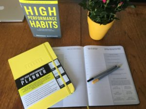 The High Performance Planner and The High Performance Habits on a table